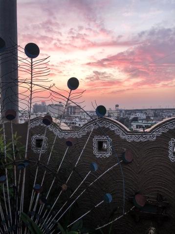 Západ slnka z Peacock Rooftop Restaurant